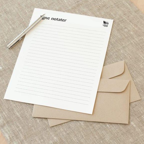 Notatblokk med trykk fra Presis